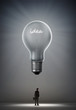 """Idea"" bulb over a businessman"