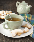 Crescents vanilla and almond cookies and cup of green tea