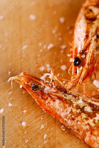 grilled shrimps prawns  with salt flakes on wood, macro