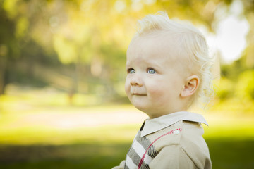 Adorable Blonde Baby Boy Outdoors at the Park.