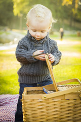 Sweet Baby Boy Opening Picnic Basket Outdoors at the Park