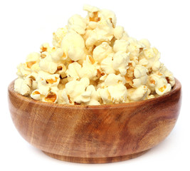 Popcorns on wooden bowl