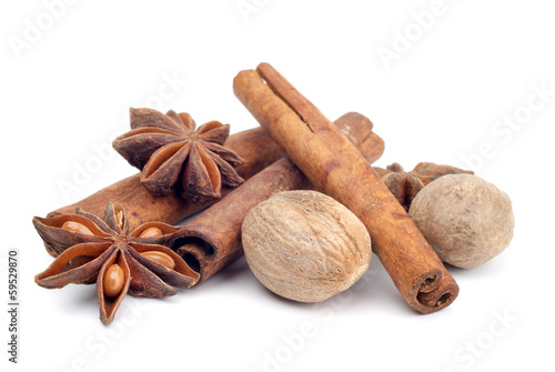anise, nutmeg and cinamon isolated on white background