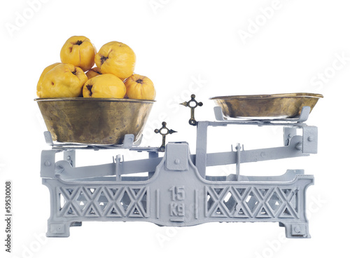 Old-fashioned balance scale with quinces