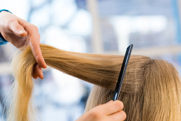 close up combing hair