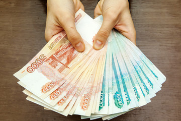 many rubles banknotes in human hands