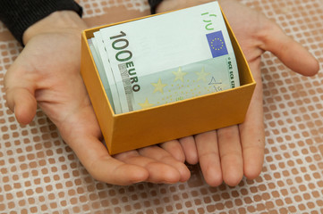 box with euro in the hands