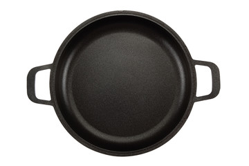 Black cast-iron frying pan on white background.
