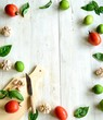 Tomato,basil and garlic with cutting board