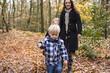 Little kids in forrest hiking