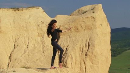 Beautiful model posing for camera in a desert