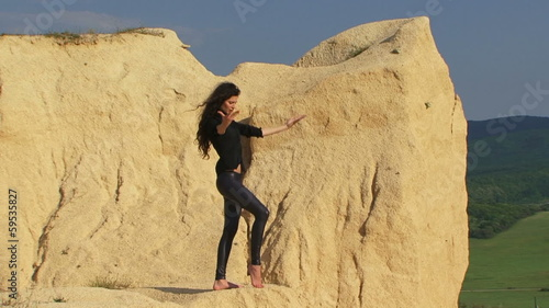 Beautiful model posing for camera in a desert