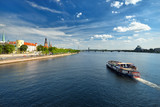 general view on Riga embarkment and river ships in bright sunny