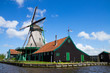 old dutch windmill over  river waters
