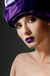 Fashion model with purple lipstick, professional makeup