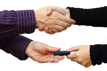 Handshake after buying a car and exchange keys