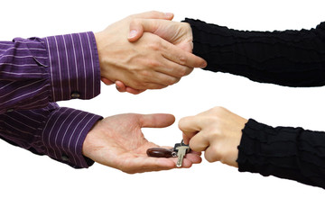 woman receiving a handshake and a house key at the same time