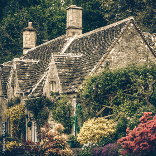Typical Cotswolds gardens in Bibury, vintage
