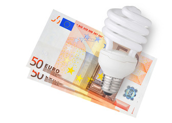 Energy saver bulb over euro bills on white background