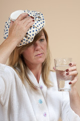 Woman using an icepack on her head