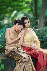 Two Thai woman wearing typical Thai dress