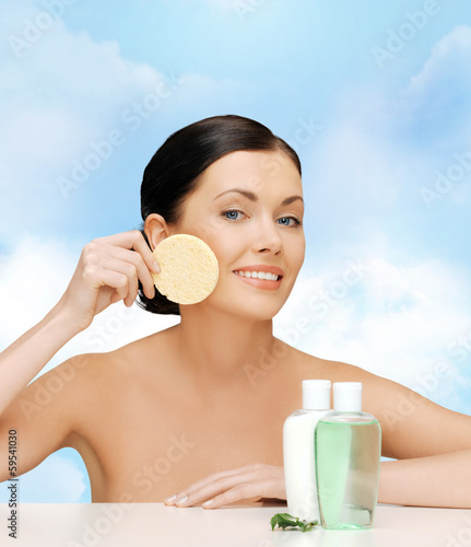 smiling woman with sponge