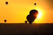 Silhouettes of balloons at sunset sky background