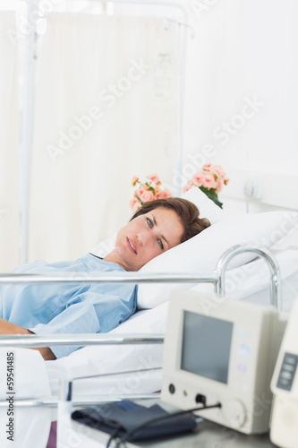 Female patient lying in medical bed