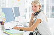 Casual woman with headset using computer in office