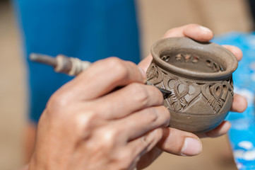 Pottery carving in hand