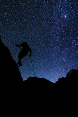 Climber on Milky Way background