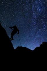 Climber on Milky Way background