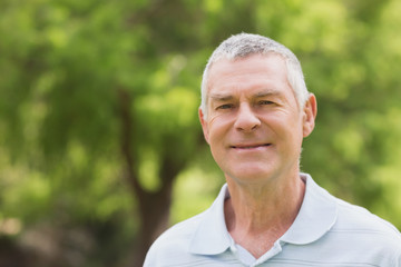 Portrait of a smiling senior man at park