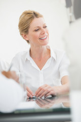 Happy businesswoman during a meeting