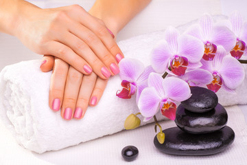 manicure with pink orchid and towel