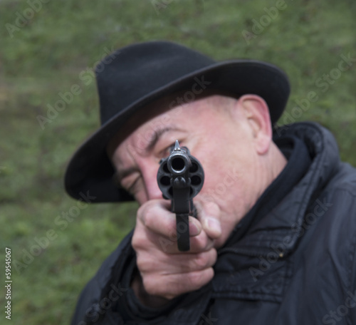 Man aiming a gun Nagan