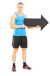 Male athlete holding a big black arrow pointing right