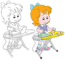 Little girl doing the ironing