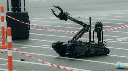 Military robot on remote control neutralizes bomb
