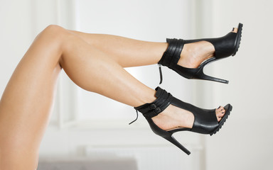 Long and sexy legs in fashionable high heels shoes