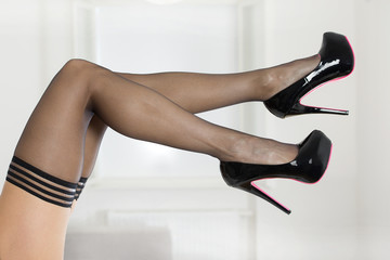Legs in stockings and high heels shoes