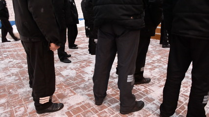 Prisoners on a walk in the winter, feet close-up