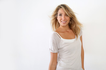 Cheerful girl standing on white background