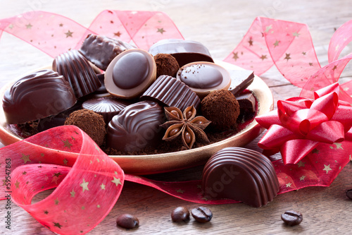 gift of chocolate sweets with a red ribbon