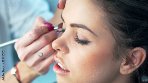Cute Brunette Getting Professional Makeup