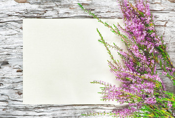 Paper with heather on the old wood