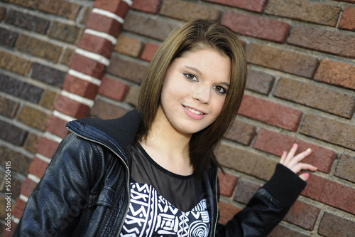 Teen by a Brick Wall