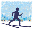 boy rides on skis in winter day