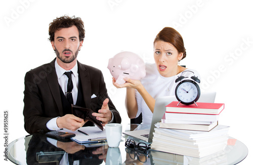 Stressed couple from financial problems, with empty piggy bank