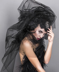 beautiful girl with black veil